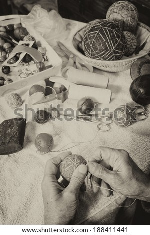 Expert hands crafting traditional sport balls - stock photo