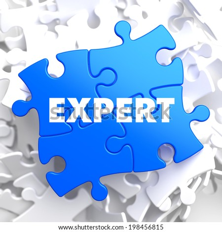 Expert on Blue Puzzle on White Background. - stock photo
