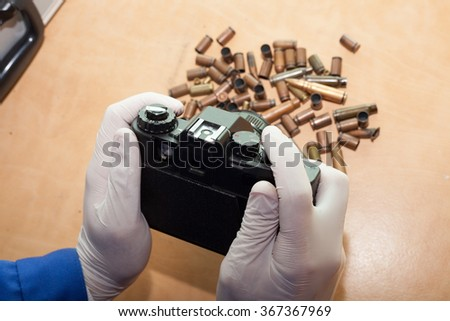 expert pictures of bullets at the crime scene. investigation - stock photo