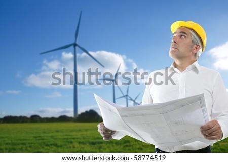 expertise architect senior engineer plan windmill aerogenerator [Photo Illustration] - stock photo