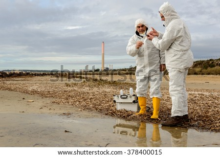 Experts analyze the water in a contaminated environment. / Polluted Water Analysis / Industrial generic district - stock photo
