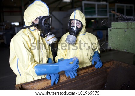 Experts analyzing suspected chemical material - stock photo