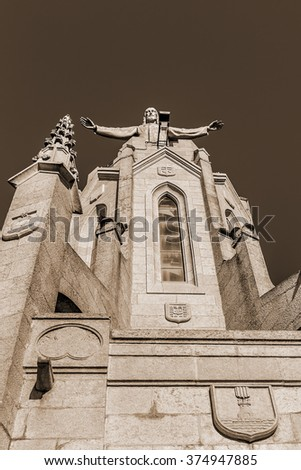 Expiatory Church of Jesus Sacred Heart (Temple Expiatori del Sagrat Cor) - Roman Catholic church and minor basilica located on summit of Mount Tibidabo in Barcelona, Catalonia, Spain. Vintage, sepia. - stock photo