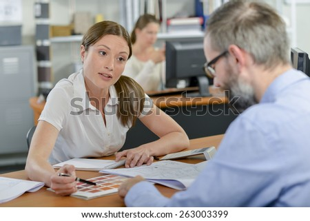 Explaing choices to client - stock photo