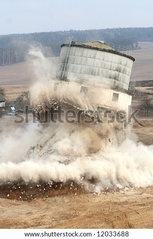 exploding and destruction old tower - stock photo