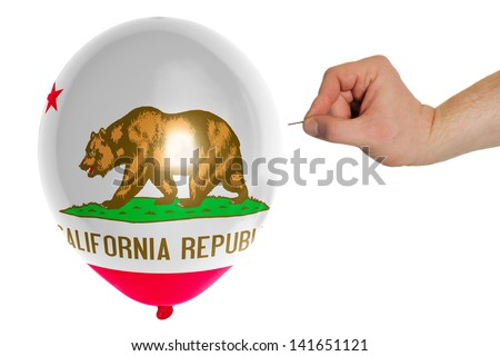 exploding balloon colored in flag of us state of california - stock photo