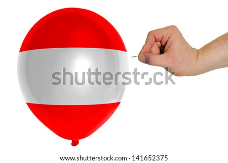 exploding balloon colored in national flag of austria - stock photo