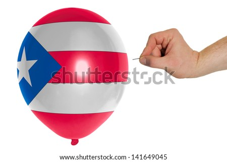 exploding balloon colored in national flag of puertorico - stock photo