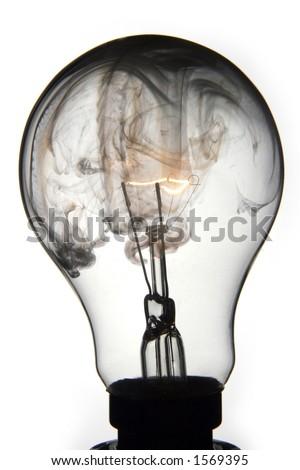 Exploding lightbulb on white background - stock photo