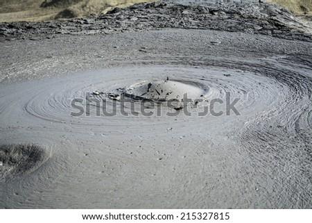 Exploding mud volcano in romania - stock photo