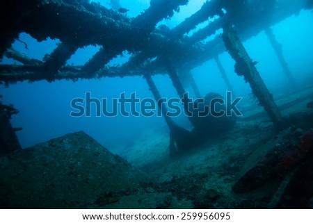 explore the wreck underwater - stock photo
