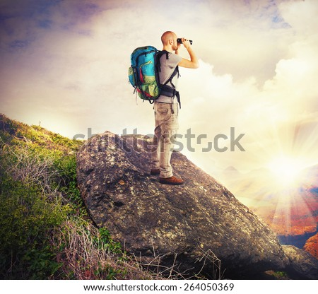 Explorer observes in search of new lands - stock photo
