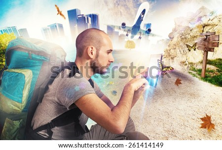 Explorer recalls his travels with his tablet - stock photo
