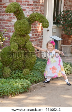Exploring beautiful garden on sunny fall day. - stock photo
