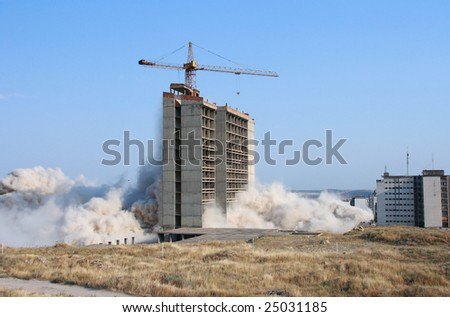 Explosion demolishing a city building - stock photo