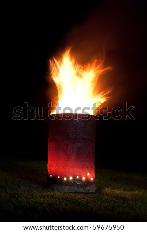 Explosion in a barrel. Long exposure night shot. - stock photo