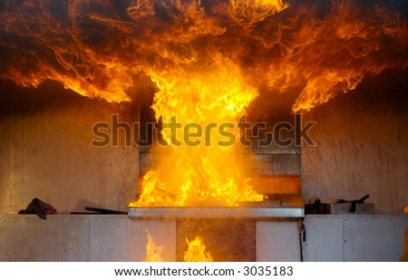 Explosion in a kitchen fire. The result of putting water on an oil fire. - stock photo