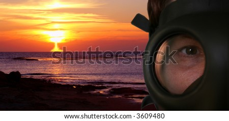 Explosion of a nuclear bomb and the person in a gas mask in the foreground - stock photo