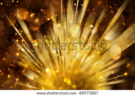 Explosion of golden lights background - stock photo