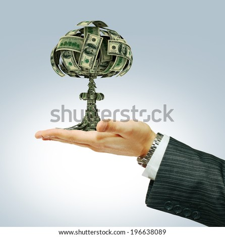 Explosion of money on businessman hand - economy concept  - stock photo