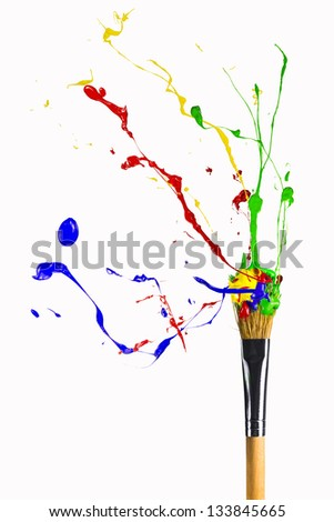 Explosion of multicolor paint on the paintbrush - stock photo