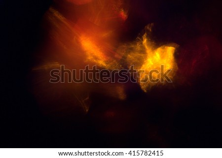Explosion of red and yellow lights on black background, digital illustration art work.