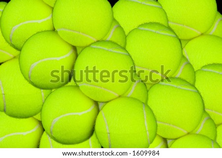 Explosion of tennis balls piled up and captured in high detail. A background for tennis lovers. - stock photo