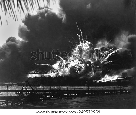 Explosion of the USS Shaw's forward magazine during the Japanese attack on Pearl Harbor, Dec. 7, 1941. The Shaw was repaired and served in the Pacific through World War 2. - stock photo