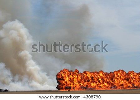 explosion on the runway during a demonstration - stock photo