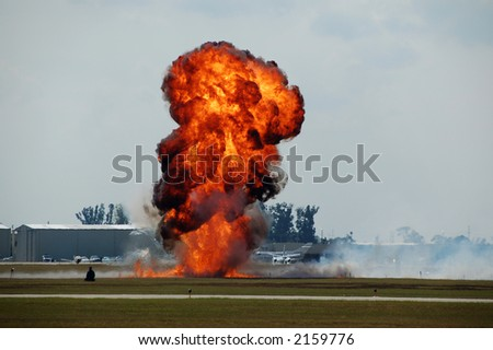Explosion with flame and smoke at airport - stock photo