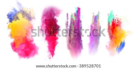 Explosions of colored powder on white background - stock photo