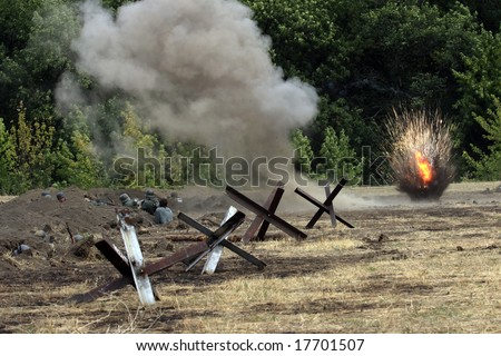"""Explosions on a battlefield. Military - historical reconstruction """" Break of Mius-front 1943 """" organized by the Military - historical Don museum in August 2008 near Taganrog, Russia - stock photo"""