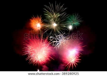 Explosive pyrotechnic display lights up night sky - stock photo