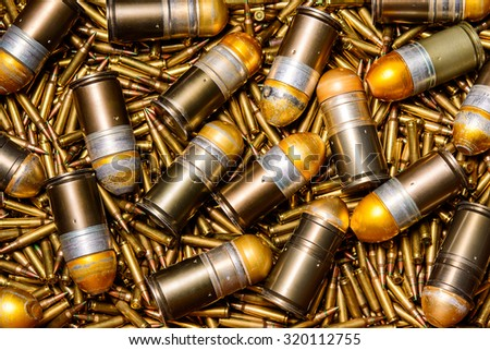 Explosive shell size 40 mm. / Ammunition, a grenade launcher - stock photo