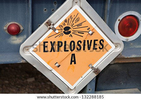 Explosive warning sign on the back of a truck - stock photo