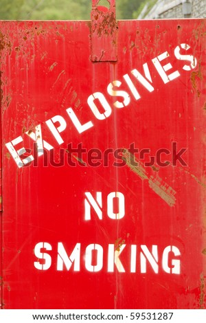 Explosives, No Smoking painted on a bunker at a city shop building
