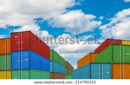 export or import shipping cargo container stacks in port - stock photo