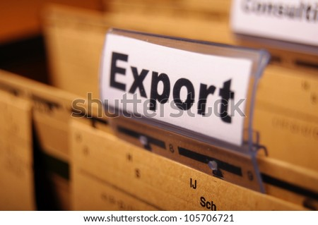 export word on business folder showing globalization trade or paperwork concept - stock photo