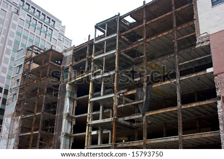 exposed beams and interior of building being demolished in boston massachusetts
