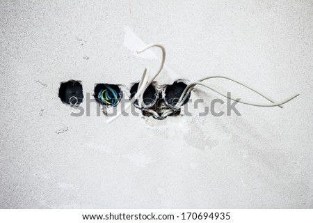 Exposed electrical wall sockets with the top covers removed for installation of the wiring for a house. - stock photo