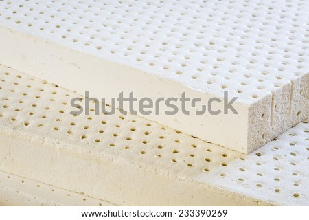 exposed layers of natural latex from an organic mattress - stock photo