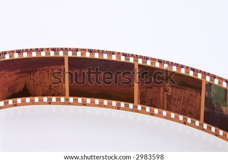 Exposed 35 mm film frames isolated on white background