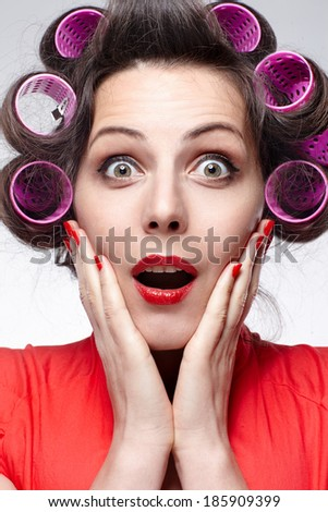 expressing woman with hair rollers