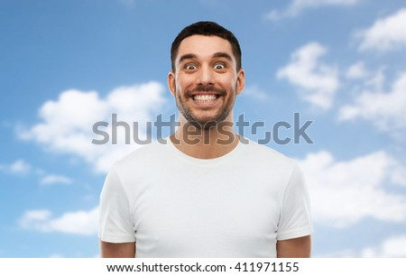 expression and people concept - man with funny face over blue sky and clouds background - stock photo