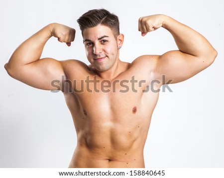 expression of a young fit man in white background - stock photo