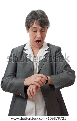 expression of late lady looking at her watch on white background - stock photo