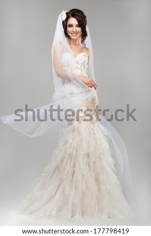 Expression. Positive Emotions. Gorgeous Smiling Bride in Windy Wedding Dress - stock photo
