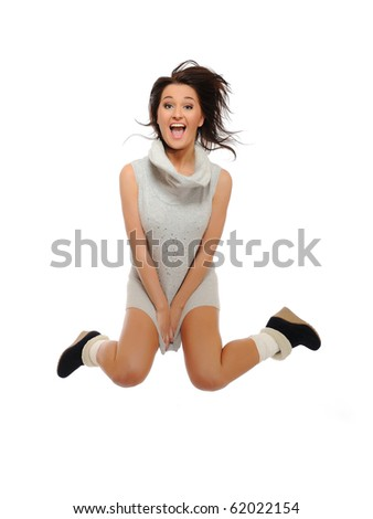 Expressions - Beautiful funny winter woman jumping and screaming. isolated on white background - stock photo