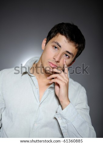 Expressions. Handsome man in white shirt feeling sad and depressed - stock photo