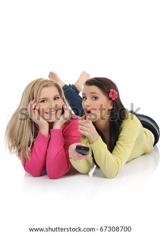 expressions.two young pretty woman friends watching television and switching channels on remote control - stock photo